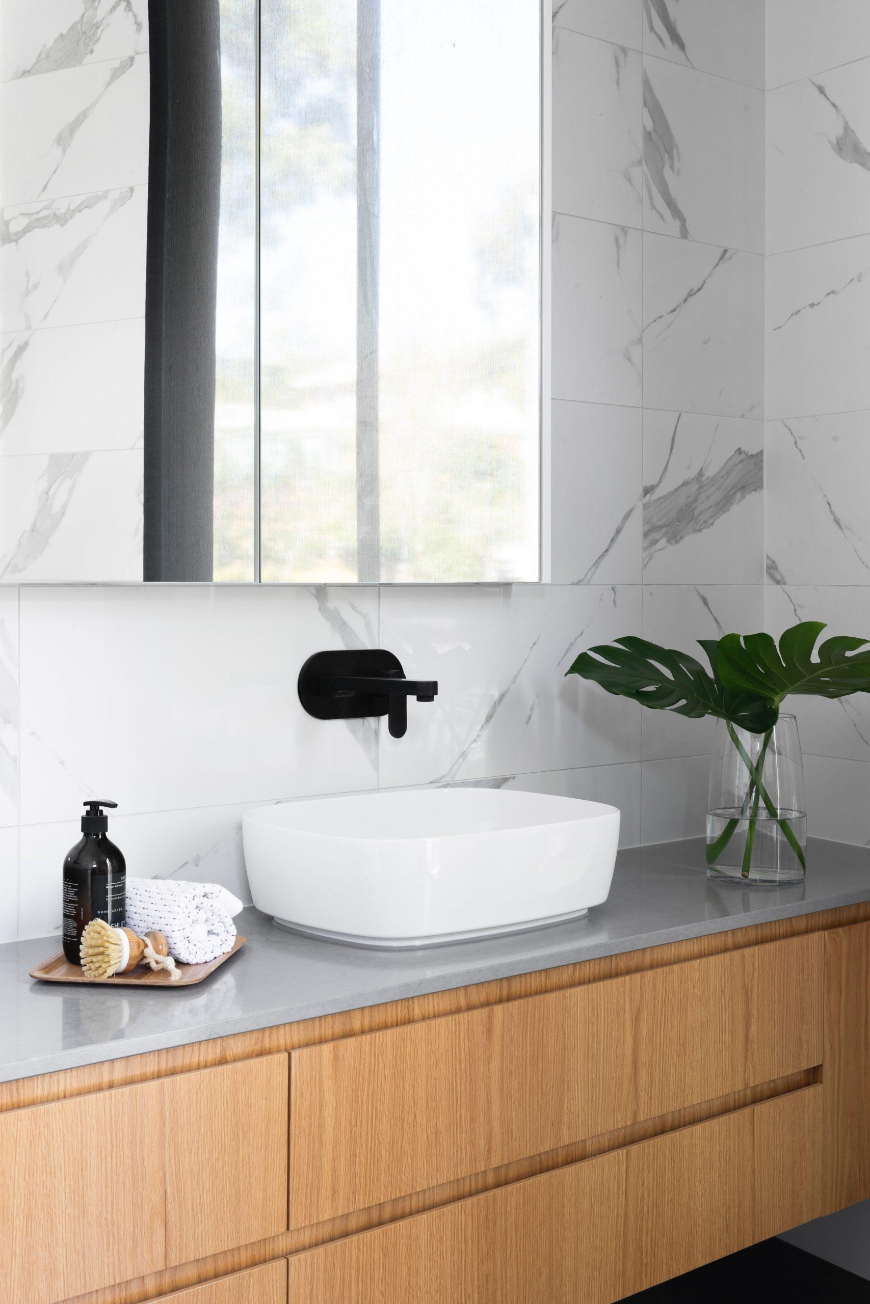 bathroom countertop with top mount sink