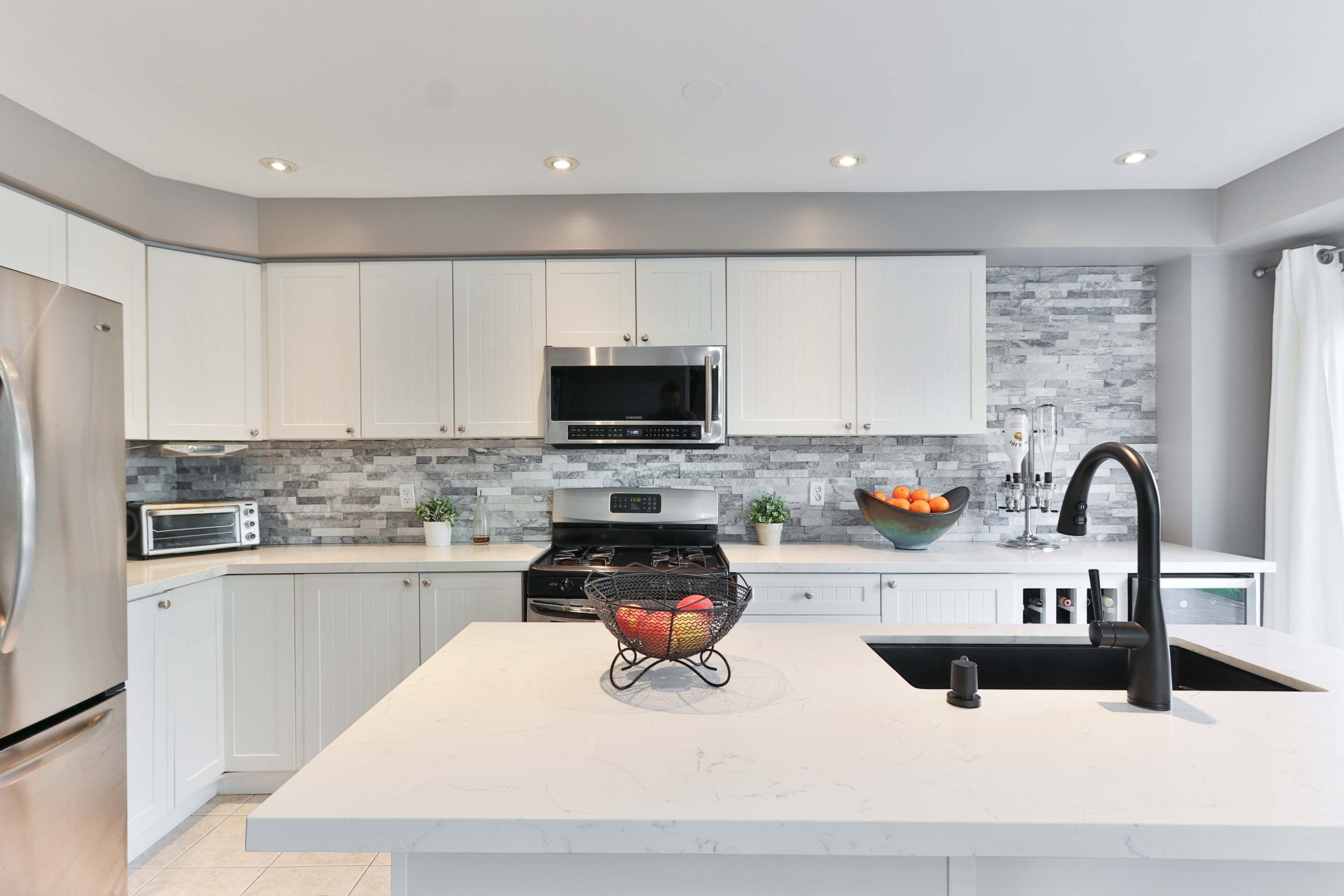 kitchen stone countertop with undermount sink L-shaped