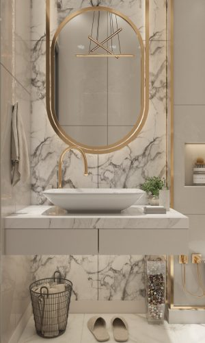 bathroom countertop with top mount sink and backsplash with gold accessories